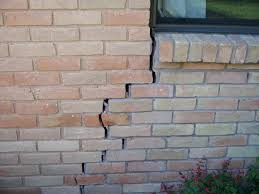 cracks in your brick ram jack can repair your foundation