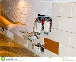 ceramic tile installation on kitchen backsplash 10 stock image