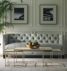 living room gray sofa gray benches white chaise lounges white