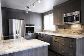 gray kiitchen cabinets white granite countertop side by side