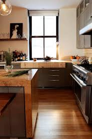 kitchen with brown cabinets and natural hardwood kitchen floors