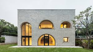 arched openings punctuate brick clad house in seoul by tectonics lab