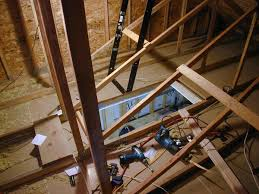 panofish installing a folding attic ladder in the garage