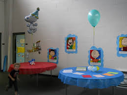 snoopy balloon arch and table decorations celebrate the day with