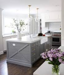 white kitchen cabinets grey island 15 gorgeous white kitchens with coloured islands the happy