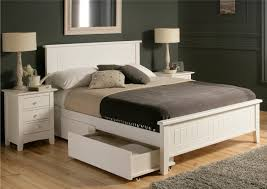 white wood bed with headboard and double storage drawers