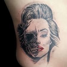 fantastic and nice marilyn monroe skull tattoo design on body