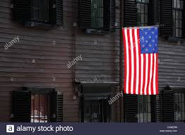 Colonial Flag A 15 Star Flag Flying In Front Of A Colonial Era House In The