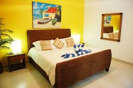 transform yellow master bedroom in yellow and grey and blue