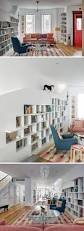 the dining room brooklyn a built in bookcase designed for cats lines an entire wall in this