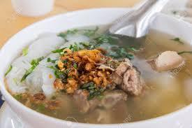 insert cuisine delicious food rice flour wrap insert pork grind in soup