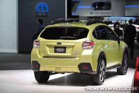 subaru yellow subaru introduces 2014 subaru forester xv crosstrek hybrid the