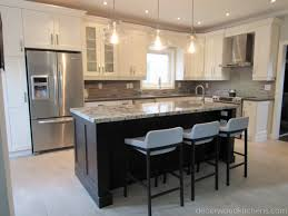 large sized open concept kitchen painted kitchen stained island