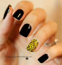 diy black and white polkadotted nail art with yellow accent 55