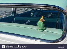 hawaiian hula dancer car dashboard ornament in back window of