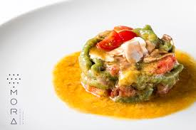 mora cuisine spinach pici pasta with cherry tomatoes at mora restaurant