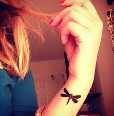 small dragonfly on wrist creativefan