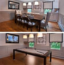 dining room table converts to pool table and tv is behind mirror