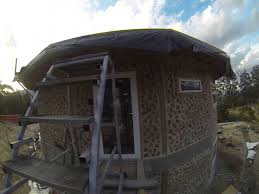 round cordwood house with earth roof finished youtube