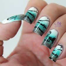 western themed stamped nail art with barbwire boots and a horse
