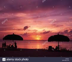 micro beach setting sun saipan sky clouds sea horizon silhouette