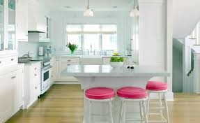u shaped kitchen design with white cabinetry and marble countertop