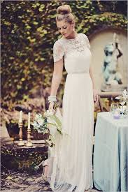 picture of lace illusion neckline wedding dress with a pleated skirt