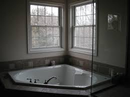 corner drop in soaking tub and single hung windows decofurnish
