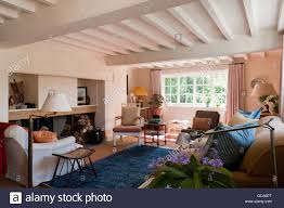 bright cottage living room with white beamed ceiling howard chair