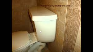 adding additional materials to wall behind toilet can create a