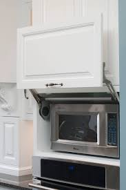 kitchen microwave cabinet from creative ways to gain extra storage space in your kitchen to