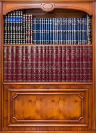 antique bookcase with jewish books in synagogue editorial photo