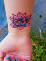 cute pink and purple lotus flower tattoo on left wrist