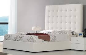white leather headboard king atestate
