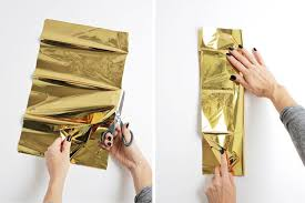 gold mylar tissue paper mylar pom pom garland a beautiful mess