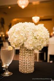 White Hydrangea Centerpiece by Tall And Low Pink And White Centerpieces Of Hydrangea And Roses In
