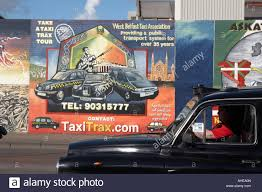 black taxi tours stock photos black taxi tours stock images alamy falls road black taxi driving past the international wall murals in the republican falls road area