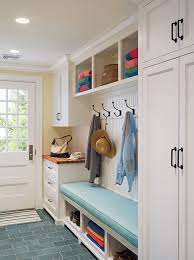 cottage mudroom features full height shaker cabinets adorned with