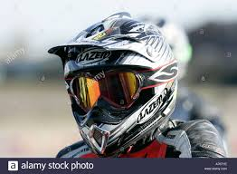 helmet motocross motocross rider in race on dusty race track stock photo royalty