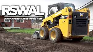 grading yard with skid steer landscaping install rswal ep