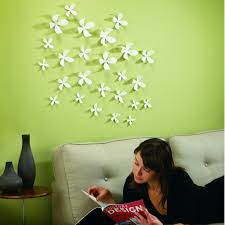 chic wall decorating idea of white fake flowers attached on the