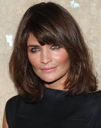 mid lengh hairstyles for over 50 with fringe side swept bangs medium length hair