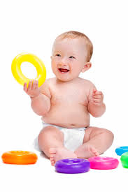 baby plastic rings images Smiling baby holding a ring looking up stock image image of jpg