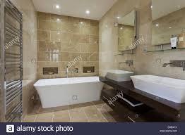 luxury bathroom with mandarin stone tiling and floor stock photo