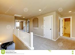 upstairs hallway in big house with beige interior paint stock