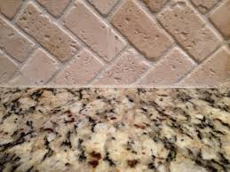 kitchen counters how to caulk stone backsplash to granite