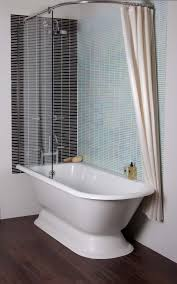 Bathrooms With Showers by White Resin Free Standing Tub With Shower Curtain And Glass Board