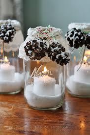 winter luminaries snowy pinecone candle jars