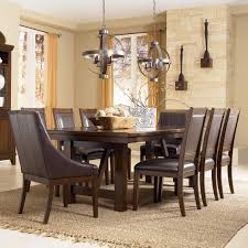 millennium holloway 9 piece extension table set w faux leather