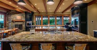 gourmet kitchen with two custom islands and a butler prep pantry